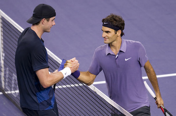 SHANGHAI, CHINA - OCTOBER 13:  Roger Federer of Switzerland shakes hand with John Isner of USA after their match during day three of the 2010 Shanghai Rolex Masters at the Shanghai Qi Zhong Tennis Center on October 13, 2010 in Shanghai, China.  (Photo by