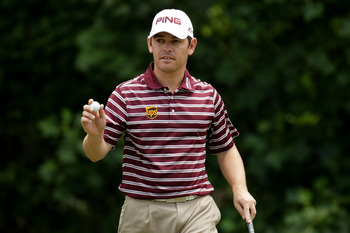 BETHESDA, MD - JUNE 16:  Louis Oosthuizen of South Africa waves to the gallery during the first round of the 111th U.S. Open at Congressional Country Club on June 16, 2011 in Bethesda, Maryland.  (Photo by Ross Kinnaird/Getty Images)