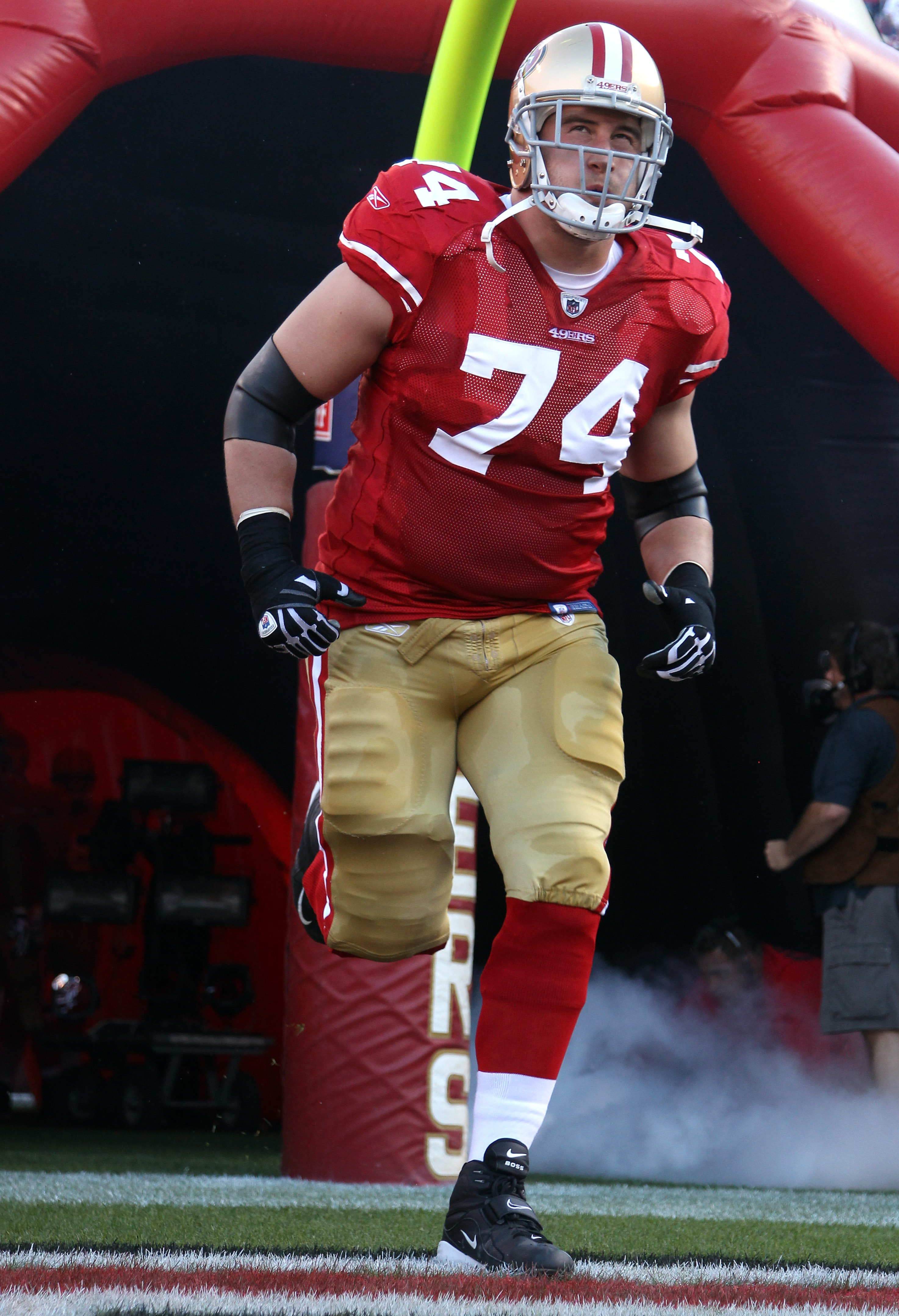 SAN FRANCISCO - SEPTEMBER 20:  Joe Staley #74 of the San Francisco 49ers runs on to the field for their game against the New Orleans Saints at Candlestick Park on September 20, 2010 in San Francisco, California.  (Photo by Ezra Shaw/Getty Images)