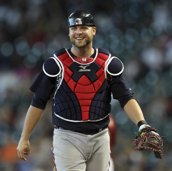 HOUSTON - JUNE 12:  Catcher Brian McCann #16 of the Atlanta Braves reacts after Jason Michaels #4 of the Houston Astros was called safe at first base on a close call at Minute Maid Park on June 12, 2011 in Houston, Texas.  (Photo by Bob Levey/Getty Images