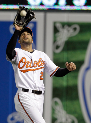 BALTIMORE, MD - JUNE 07: Right fielder Nick Markakis #21 of the Baltimore Orioles makes a catch for an out against the Oakland Athletics at Oriole Park at Camden Yards on June 7, 2011 in Baltimore, Maryland.  (Photo by Rob Carr/Getty Images)