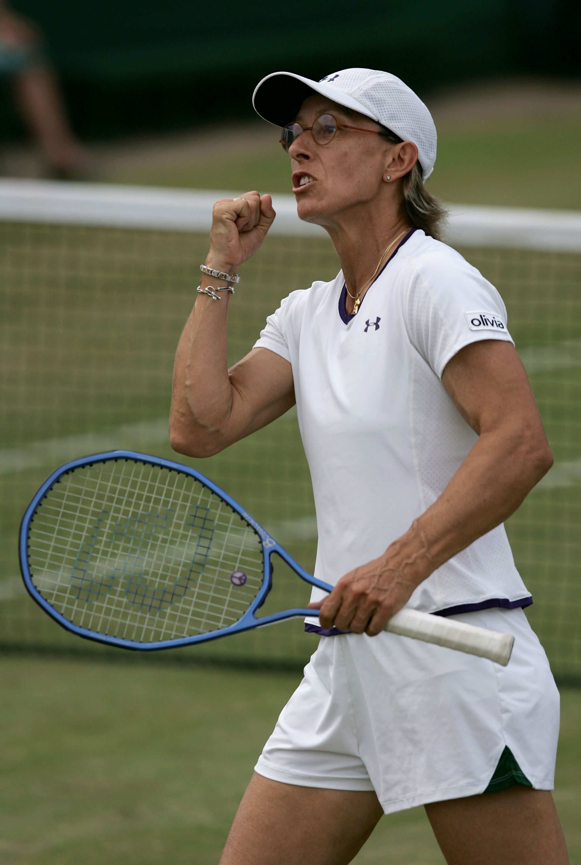 LONDON - JUNE 29:  Martina Navratilova of the USA celebrates winning a game during her doubles match with Anna-Lena Groenefeld of Germany against Vera Douchevina of Russia and Shahar Peer of Israel in the Ladies Doubles during the ninth day of the Wimbled