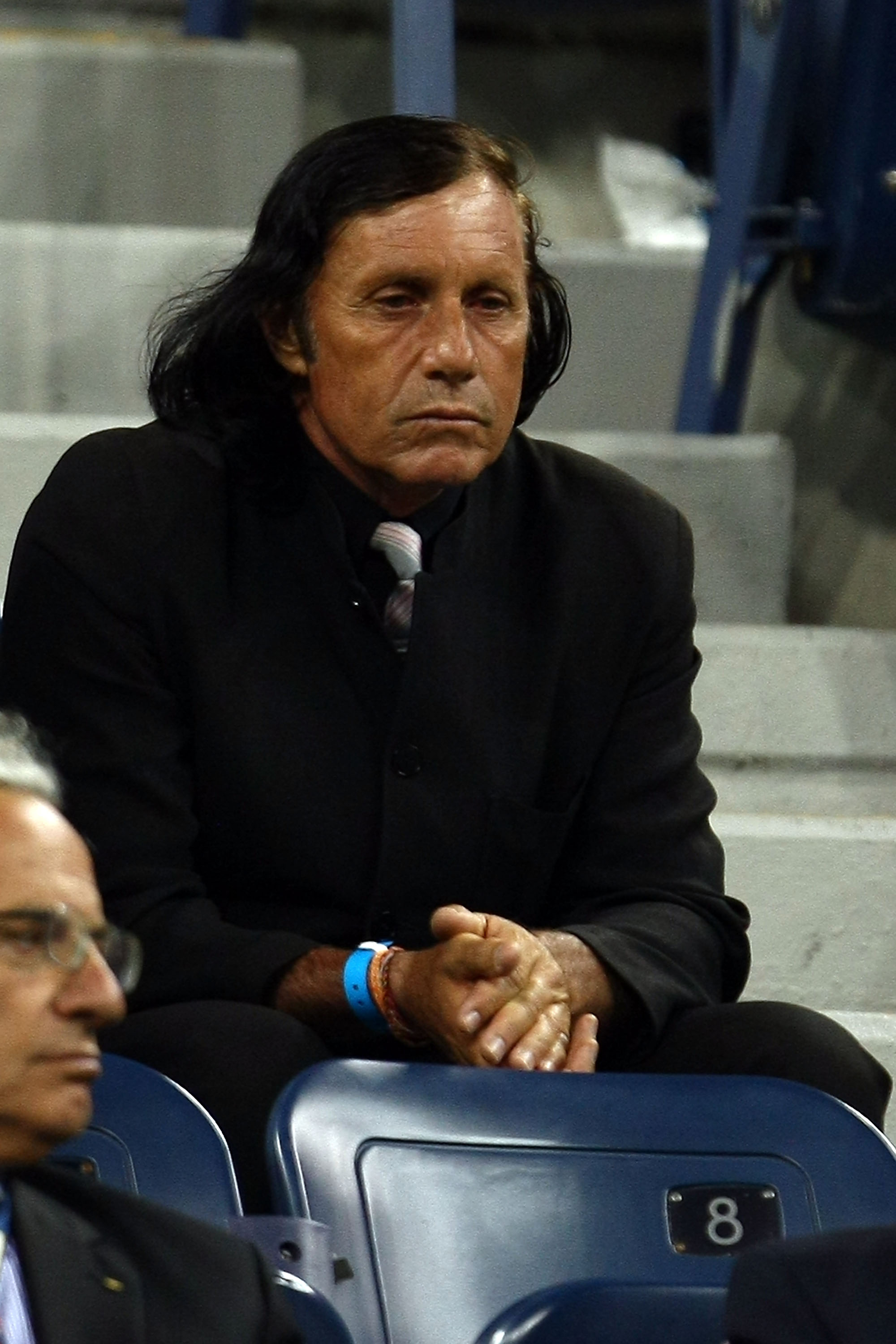 NEW YORK - SEPTEMBER 09:  Former tennis player Guillermo Vilas (R) attends the night session of day ten of the 2009 U.S. Open at the USTA Billie Jean King National Tennis Center on September 9, 2009 in the Flushing neighborhood of the Queens borough of Ne