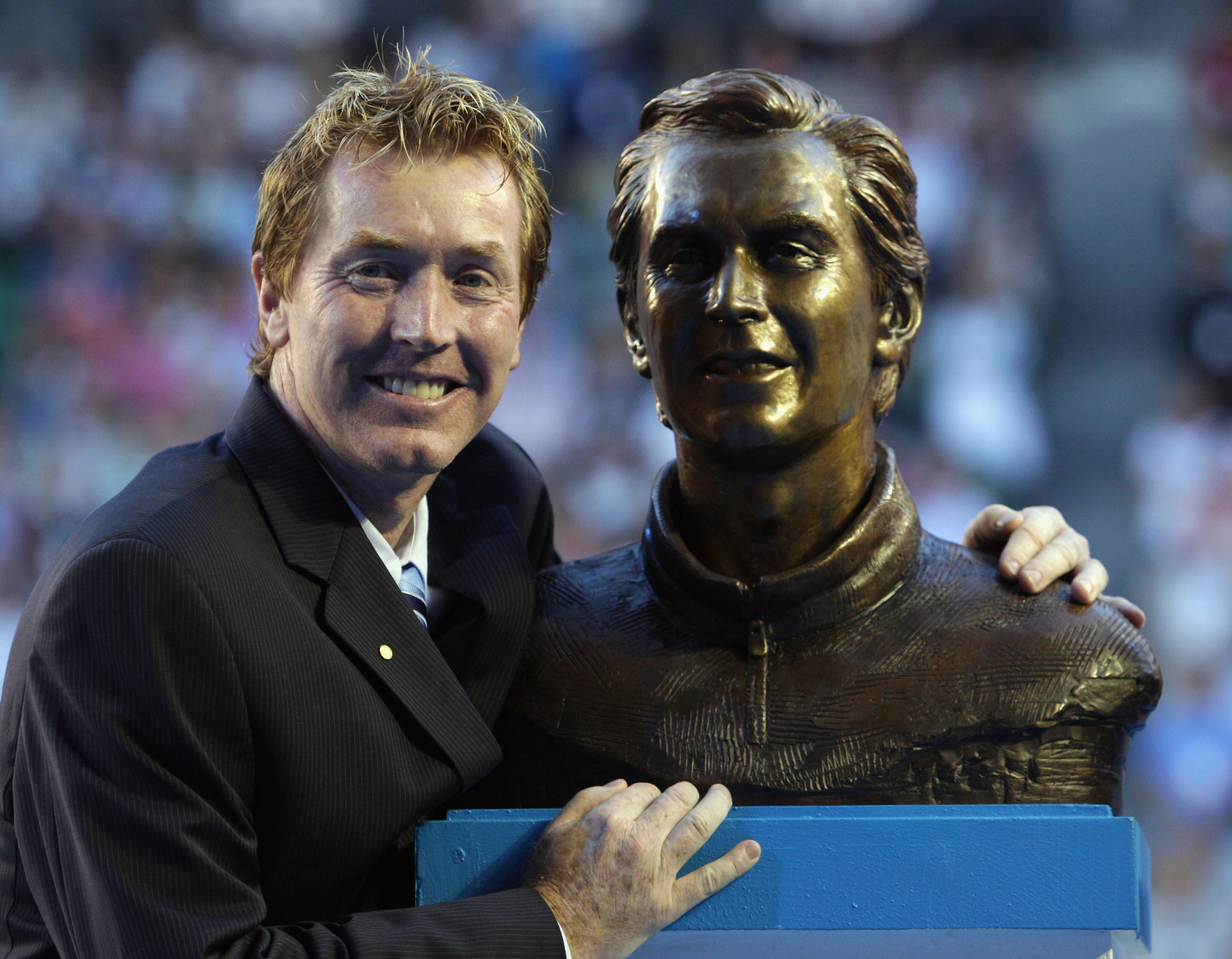MELBOURNE, AUSTRALIA - JANUARY 26:  Former tennis player Mark Woodforde of Australia poses after being inducted into the Australian Tennis Hall of Fame during the Australia Day presentation in Rod Laver Arena during day nine of the 2010 Australian Open at