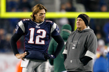 FOXBORO, MA - DECEMBER 19:  Quarterback Tom Brady #12 of the New England Patriots talks with head coach Bill Belichick before playing against the Green Bay Packers at Gillette Stadium on December 19, 2010 in Foxboro, Massachusetts.  The Patriots won the g