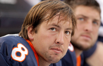 DENVER - OCTOBER 24:  Quarterbacks Kyle Orton #8 and Tim Tebow #15 of the Denver Broncos look on from the bench during their 59-14 loss to the Oakland Raiders at INVESCO Field at Mile High on October 24, 2010 in Denver, Colorado. (Photo by Justin Edmonds/