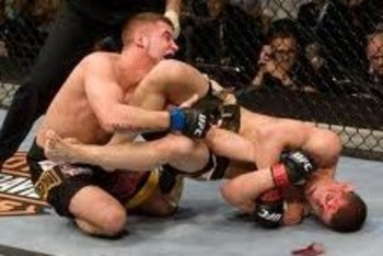 Joe Lauzon securing an arm bar submission victory