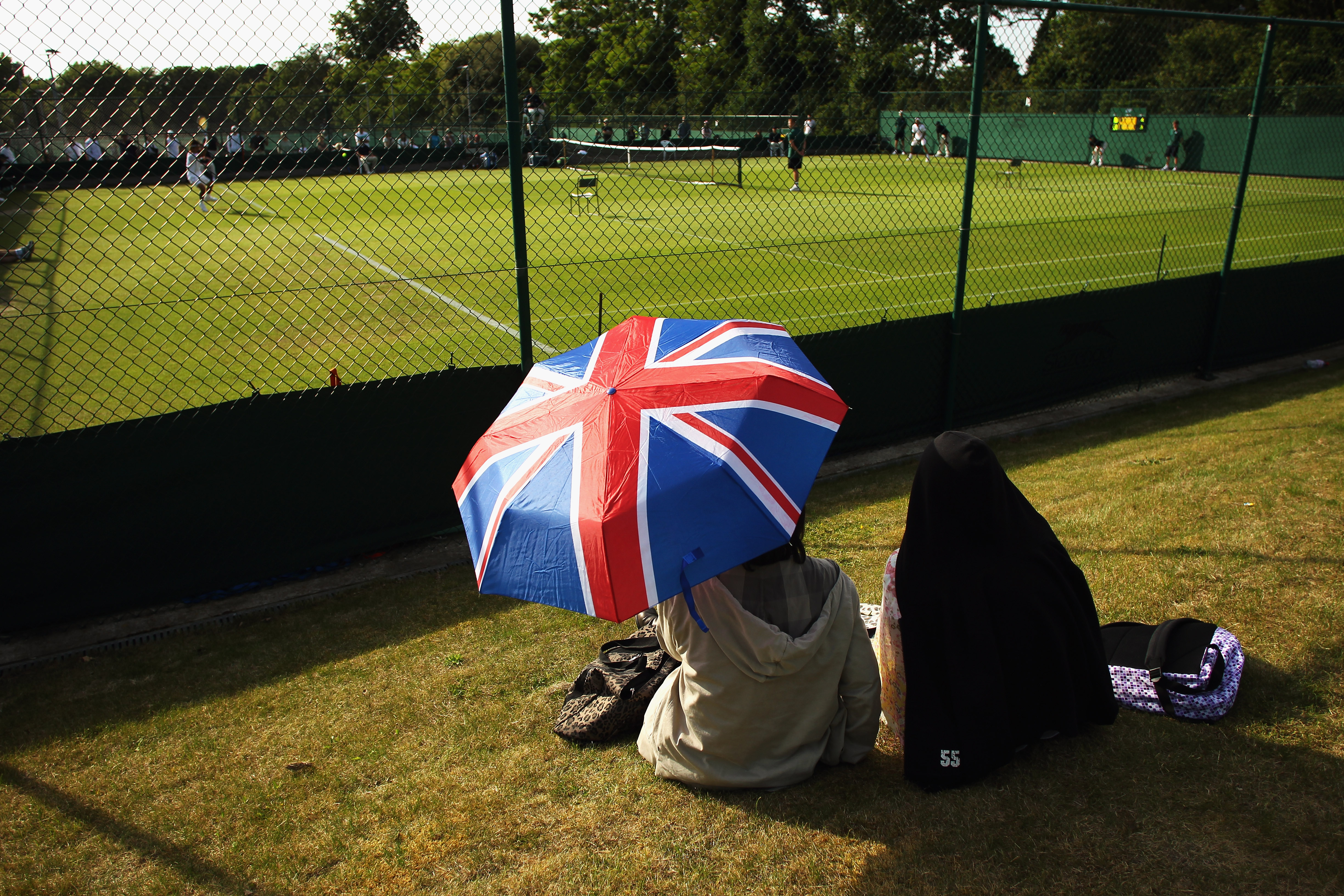 LONDON, ENGLAND - JUNE 14:  Spectators enjoy day two of the Wimbledon Championships 2011 Qualifying at the Bank of England Sports Ground on June 14, 2011 in London, England.  (Photo by Bryn Lennon/Getty Images)