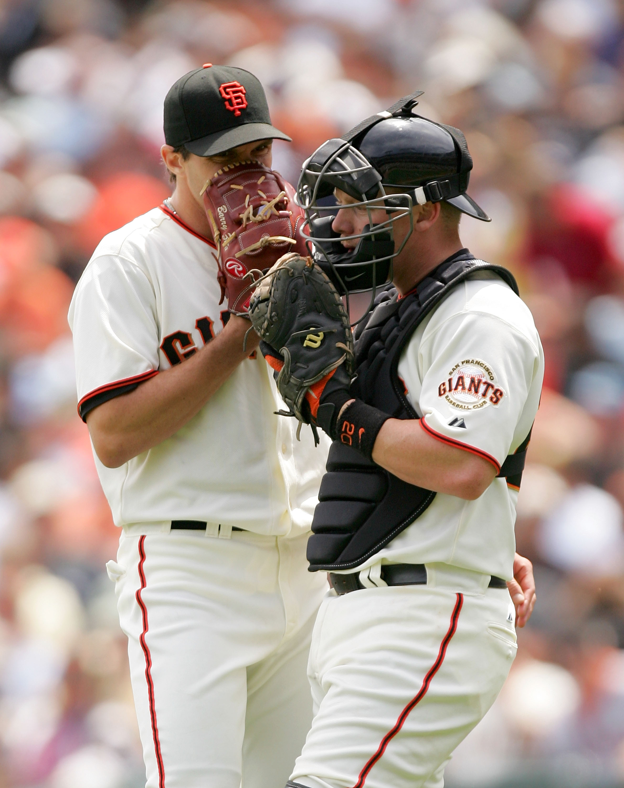 SAN FRANCISCO - MAY 13:  Catcher Steve Holm #20 speaks with Barry Zito #75 of the San Francisco Giants during their game against the Washington Nationals at AT&T Park on May 13, 2009 in San Francisco, California.  (Photo by Ezra Shaw/Getty Images)