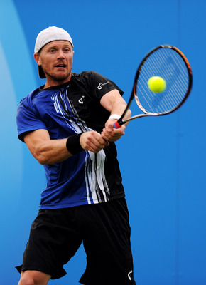 LONDON, ENGLAND - JUNE 06:  Alex Bogomolov, Jr. of the United States returns the ball during his Men's Singles first round match against Igor Kunitsyn of Russia on day one of the AEGON Championships at Queens Club on June 6, 2011 in London, England.  (Pho