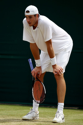 LONDON, ENGLAND - JUNE 25:  John Isner of USA rests during his match against Thiemo De Bakker of Netherlands on Day Five of the Wimbledon Lawn Tennis Championships at the All England Lawn Tennis and Croquet Club on June 25, 2010 in London, England.  (Phot