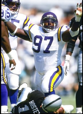 5 Sep 1993:  Defensive lineman Henry Thomas of the Minnesota Vikings celebrates during a game against the Los Angeles Raiders at the Los Angeles Memorial Coliseum in Los Angeles, California.  The Raiders won the game, 24-7. Mandatory Credit: Stephen Dunn