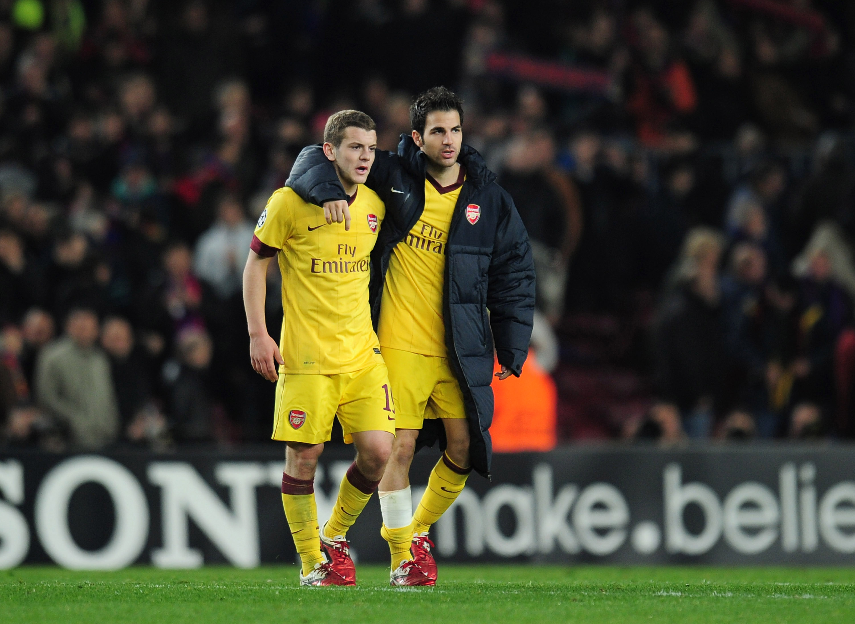 BARCELONA, SPAIN - MARCH 08:  Jack Wilshere and Cesc Fabregas of Arsenal leave the field at the end of the UEFA Champions League round of 16 second leg match between Barcelona and Arsenal at the Nou Camp Stadium on March 8, 2011 in Barcelona, Spain.  (Pho