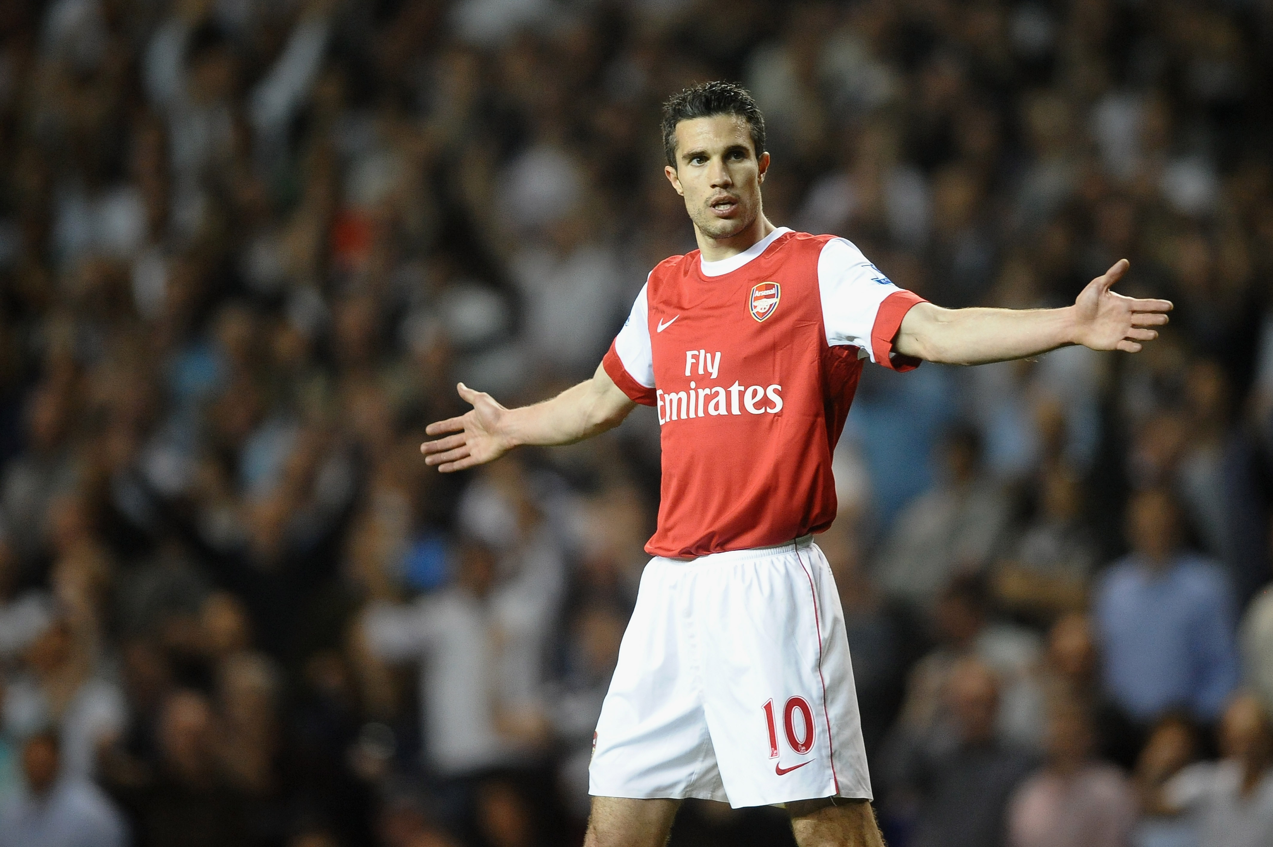 LONDON, ENGLAND - APRIL 20:  Robin van Persie of Arsenal reacts during the Barclays Premier League match between Tottenham Hotspur and Arsenal at White Hart Lane on April 20, 2011 in London, England.  (Photo by Laurence Griffiths/Getty Images)