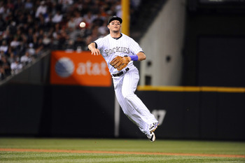 DENVER, CO - JUNE 17:  Troy Tulowitzki #2 of the Colorado Rockies throws to first base during the game against the Detroit Tigers at Coors Field on June 17, 2011 in Denver, Colorado.  (Photo by Garrett W. Ellwood/Getty Images)