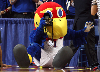 MINNEAPOLIS - MARCH 22:  Jayhawk, the mascot for the Kansas Jayhawks takes pictures with a camera from the photographer row against the Dayton Flyers during the second round of the NCAA Division I Men's Basketball Tournament at the Hubert H. Humphrey Metr