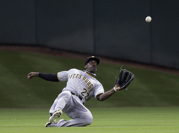 HOUSTON - JUNE 15:  Center fielder Andrew McCutchen #22 of the Pittsburgh Pirates makes a sliding catch against the Houston Astros at Minute Maid Park on June 15, 2011 in Houston, Texas.  (Photo by Bob Levey/Getty Images)