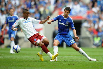 LONDON, ENGLAND - MAY 15:  Michael Ballack of Chelsea is tackled and fouled by Kevin Prince Boateng of Portsmouth during the FA Cup sponsored by E.ON Final match between Chelsea and Portsmouth at Wembley Stadium on May 15, 2010 in London, England.  (Photo