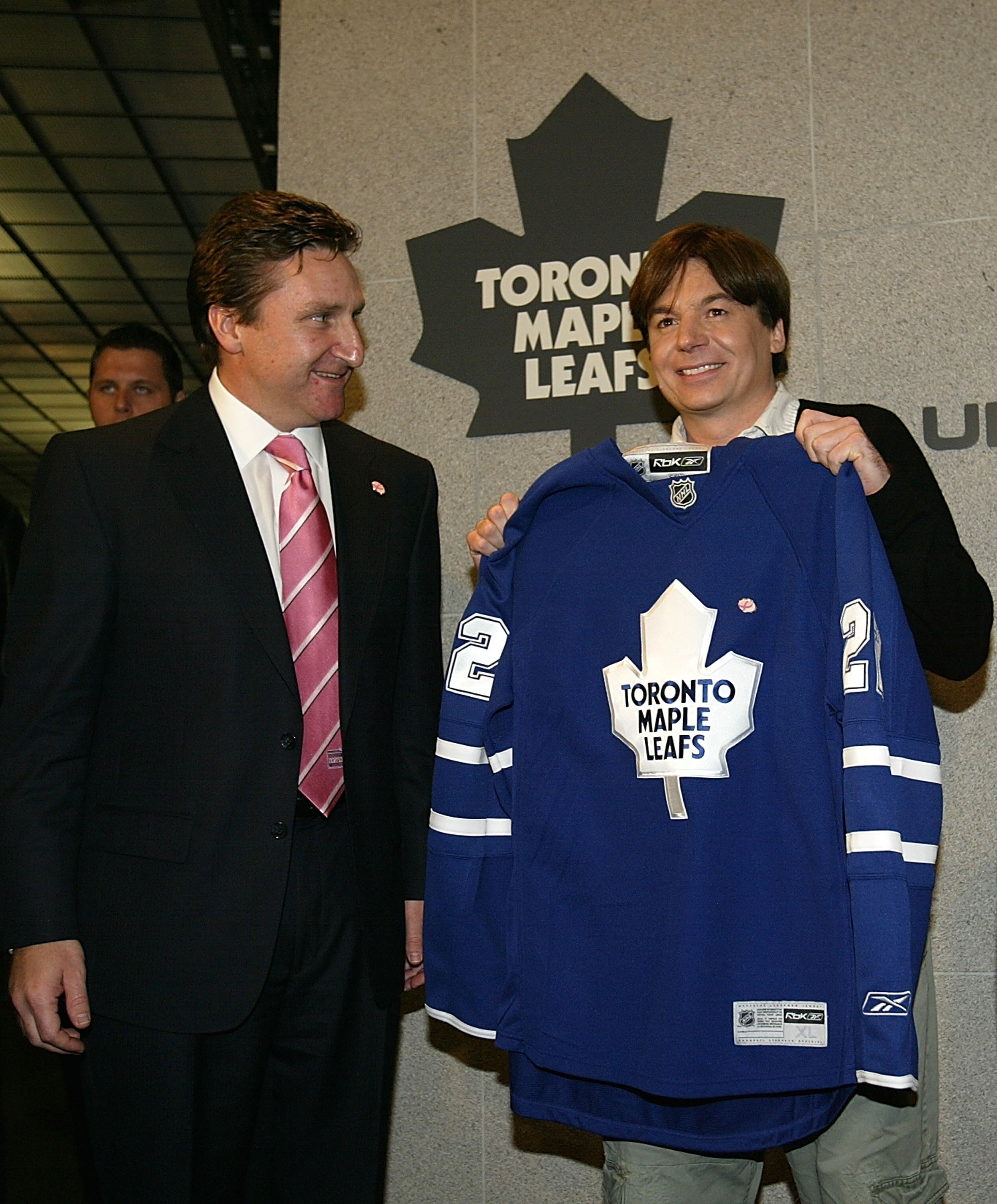 TORONTO - OCTOBER 13:  Toronto Maple Leafs vice-president and general manager John Ferguson (L) presentsCanadian actor and long time Maple Leafs fan Mike Myers with a jersey in Toronto during their NHL game against the Pittsburgh Penguins at the Air Canad