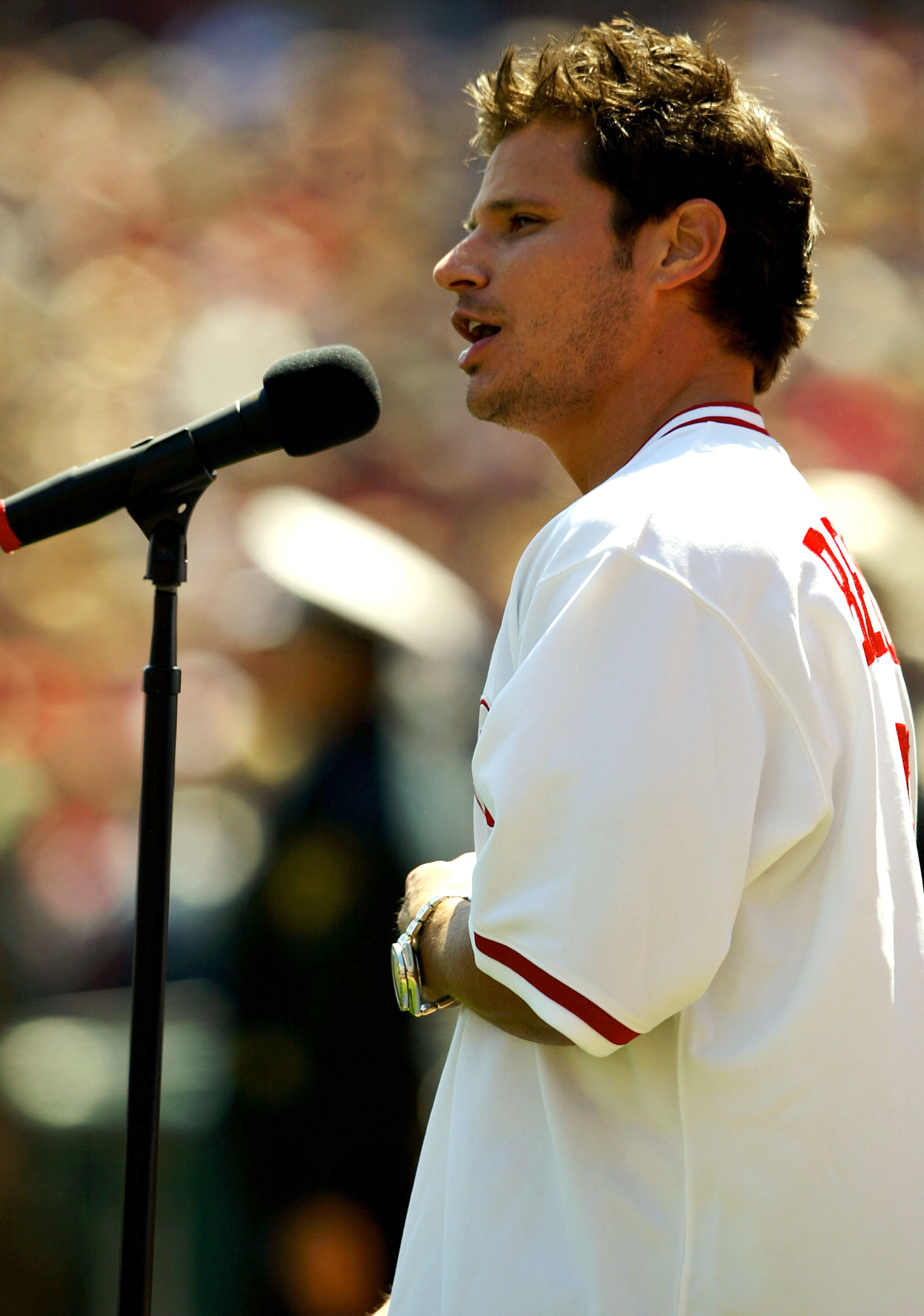 CINCINNATI - APRIL 5:  Nick Lachey, a native of Cincinnati, sings the National Anthem before the start of the National League game between the Cincinnati Reds and the Chicago Cubs on April 5, 2004 at Great American Ballpark in Cincinnati, Ohio.  (Photo by