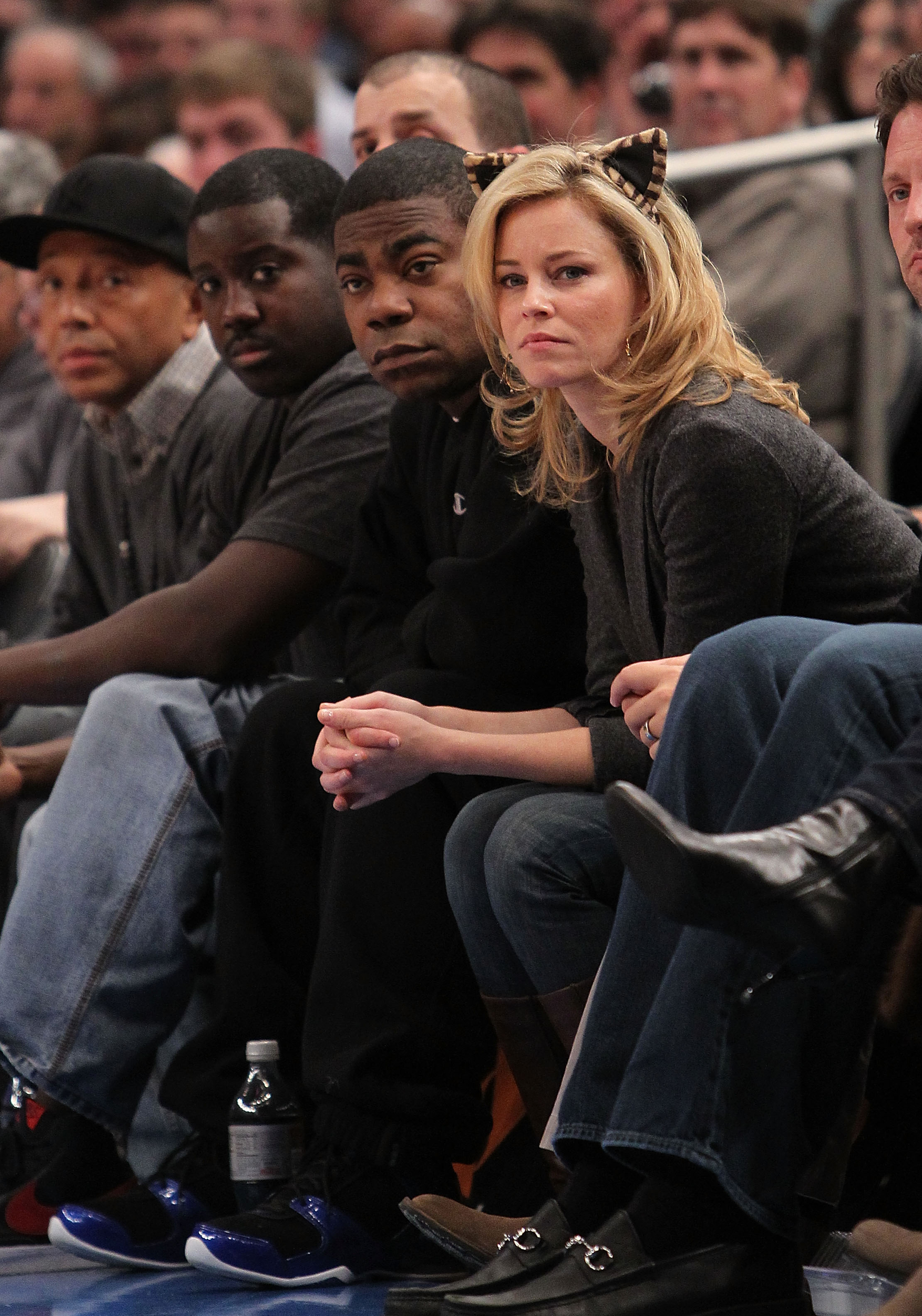 NEW YORK - OCTOBER 30:  Comedian Tracy Morgan and actress Elizabeth Banks look on during the game between the New York Knicks and the Portland Trail Blazers at Madison Square Garden on October 30, 2010 in New York City. NOTE TO USER: User expressly acknow