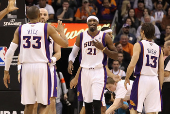 PHOENIX, AZ - JANUARY 14:  Hakim Warrick #21 of the Phoenix Suns celebrates with teammates Grant Hill #33 and Steve Nash #13 after scoring against the Portland Trail Blazers during the NBA game at US Airways Center on January 14, 2011 in Phoenix, Arizona.