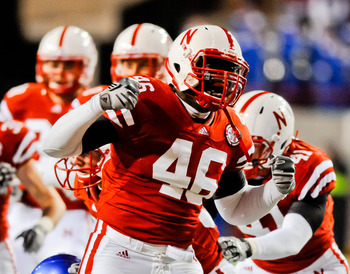 LINCOLN, NE - NOVEMBER 13: Eric Martin #46 of the Nebraska Cornhuskers celebrates a big hit during first half action of their game at Memorial Stadium on November 13, 2010 in Lincoln, Nebraska. (Photo by Eric Francis/Getty Images)