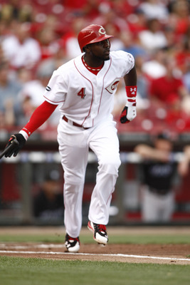 CINCINNATI, OH - JUNE 17:  Brandon Phillips #4 of the Cincinnati Reds hits a double to right center field during against the Toronto Blue Jays on June 17, 2011 at Great American Ball Park in Cincinnati, Ohio.  The Toronto Blue Jays defeated the Cincinnati
