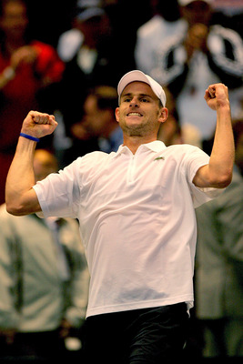 BIRMINGHAM, AL - MARCH 08:  Andy Roddick celebrates his win over Stanislas Wawrinka of Switzerland in the first set during the fourth rubber of their Davis Cup tie at Birmingham-Jefferson Convention Complex Arena March 8, 2009 in Birmingham, Alabama.  (Ph