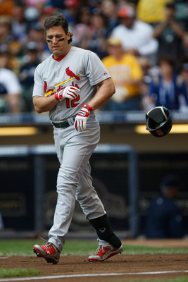 MILWAUKEE, WI - JUNE 12: Lance Berkman #12 of the St. Louis Cardinals throws his batting helmet after a strike out against the Milwaukee Brewers at Miller Park on June 12, 2011 in Milwaukee, Wisconsin. (Photo by Scott Boehm/Getty Images)
