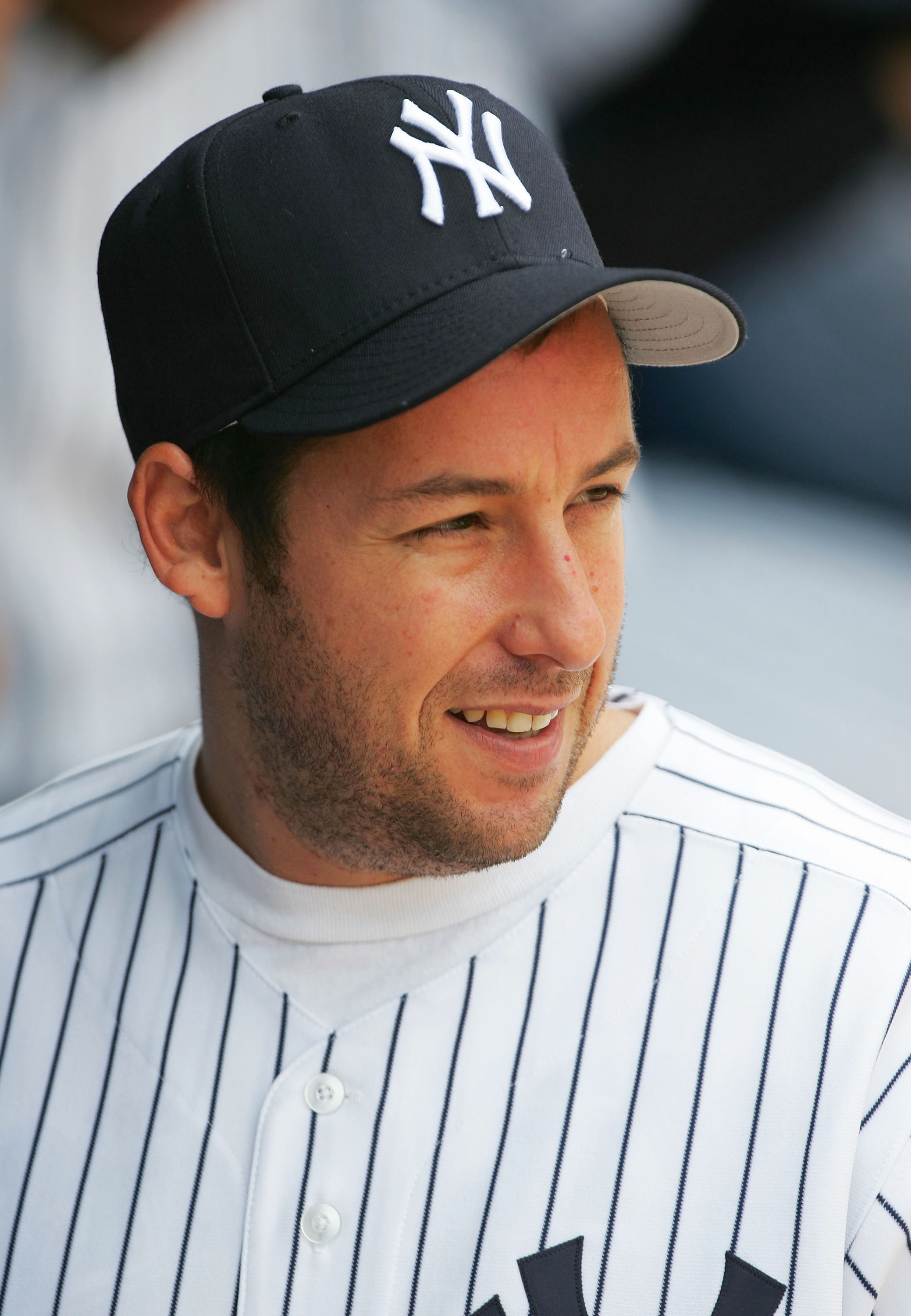 NEW YORK - MAY 28:  Actor Adam Sandler looks on from the dugout before throwing out the ceremonial first pitch in honor of his new film, 'The Longest Yard' which opened this weekend before the start of the game between New York Yankees and the Boston Red