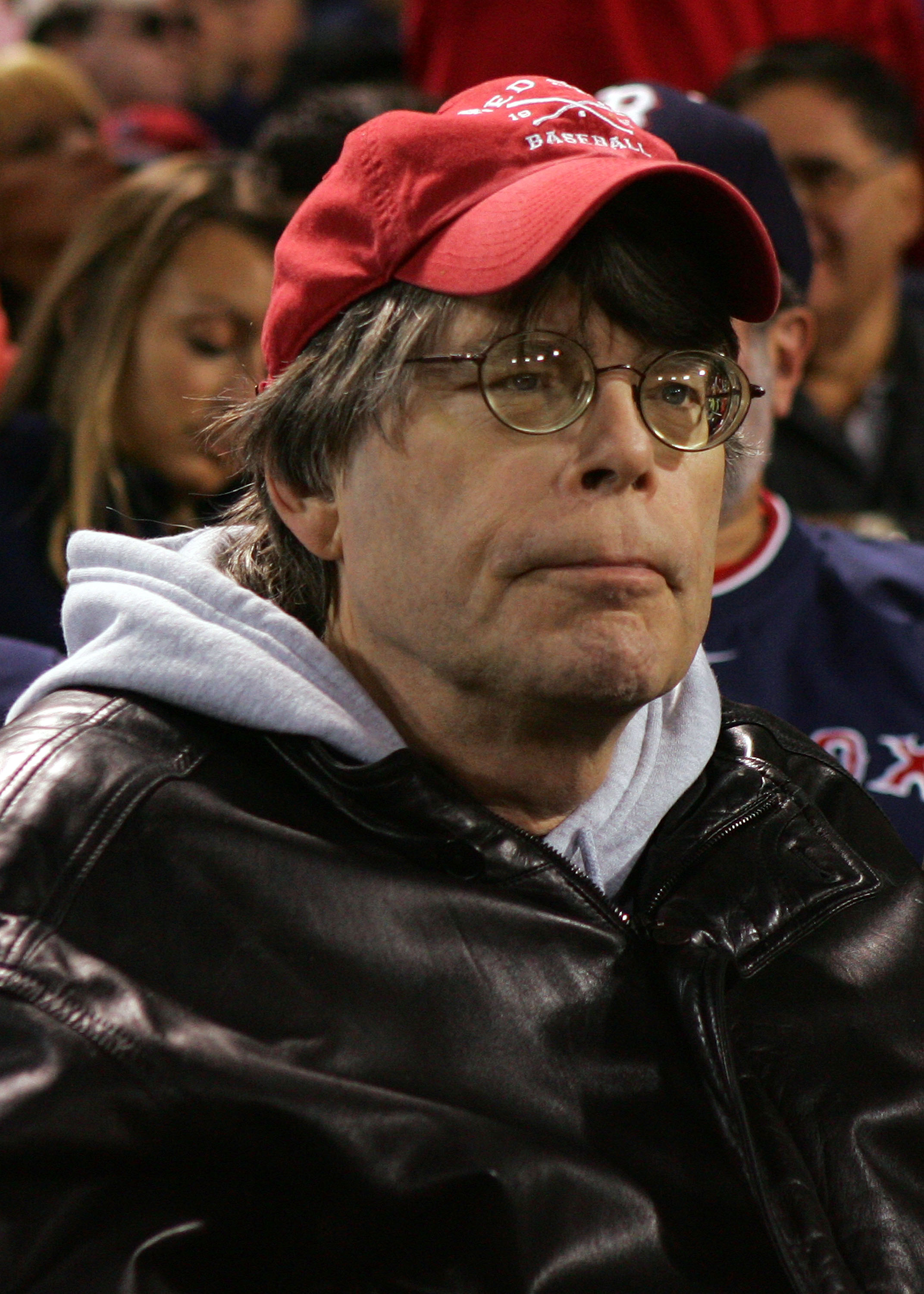 BOSTON - OCTOBER 13:  Author Stephen King watches as the Tampa Bay Rays play against the Boston Red Sox during game three of the American League Championship Series against during the 2008 MLB playoffs at Fenway Park on October 13, 2008 in Boston, Massach