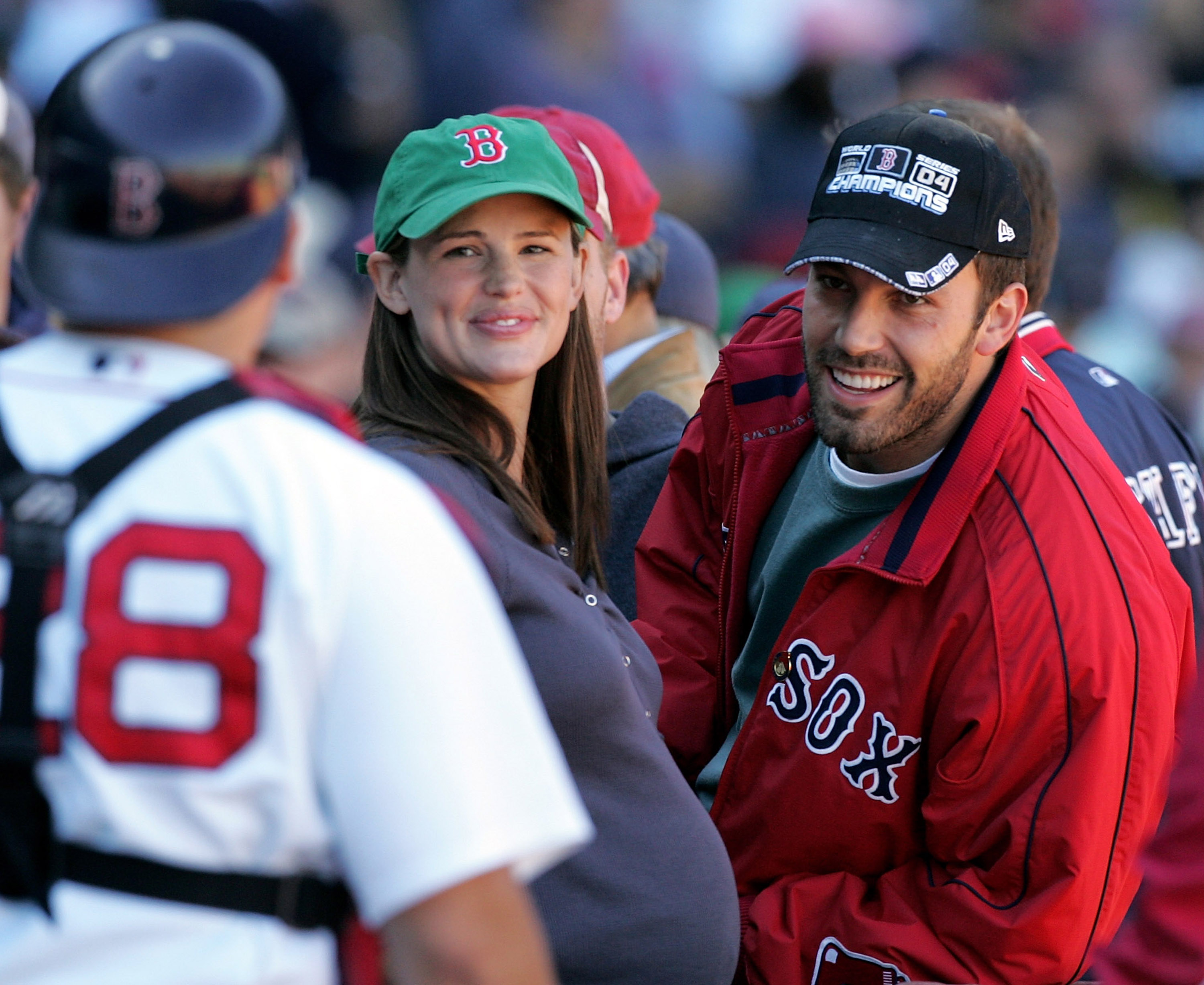 BOSTON - OCTOBER 01:  Actor Ben Affleck and wife, actress Jennifer Garner smile at catcher Doug Mirabelli #28 of the Boston Red Sox as they attend the game against the New York Yankees during the game at Fenway Park on October 1, 2005 in Boston, Massachus