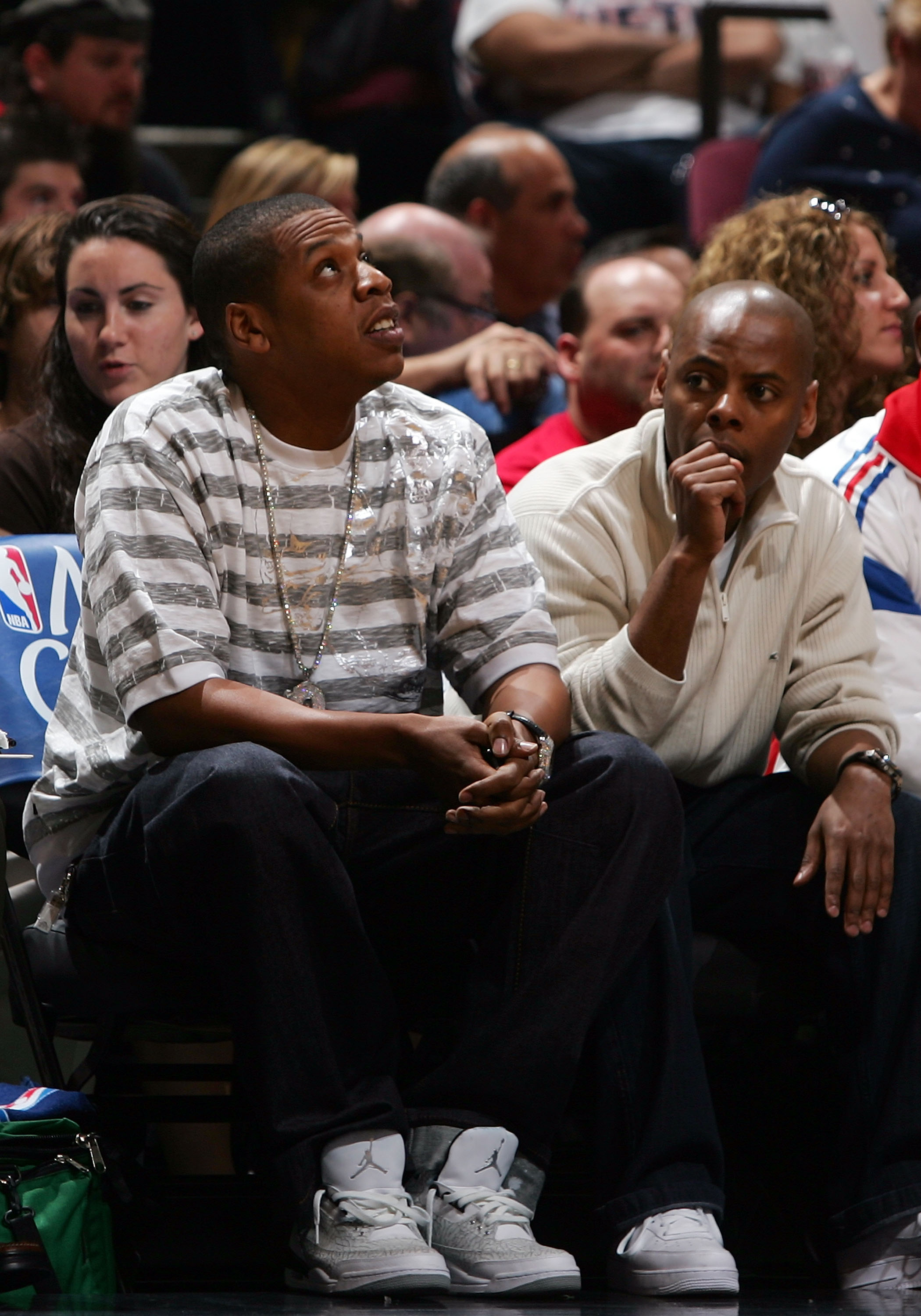EAST RUTHERFORD, NJ - MAY 12:  Rapper Jay-Z (L) watches as the New Jersey Nets take on the Cleveland Cavaliers during Game Three of the Eastern Conference Semifinals during the 2007 NBA Playoffs on May 12, 2007 at the Continental Airlines Arena in the Mea