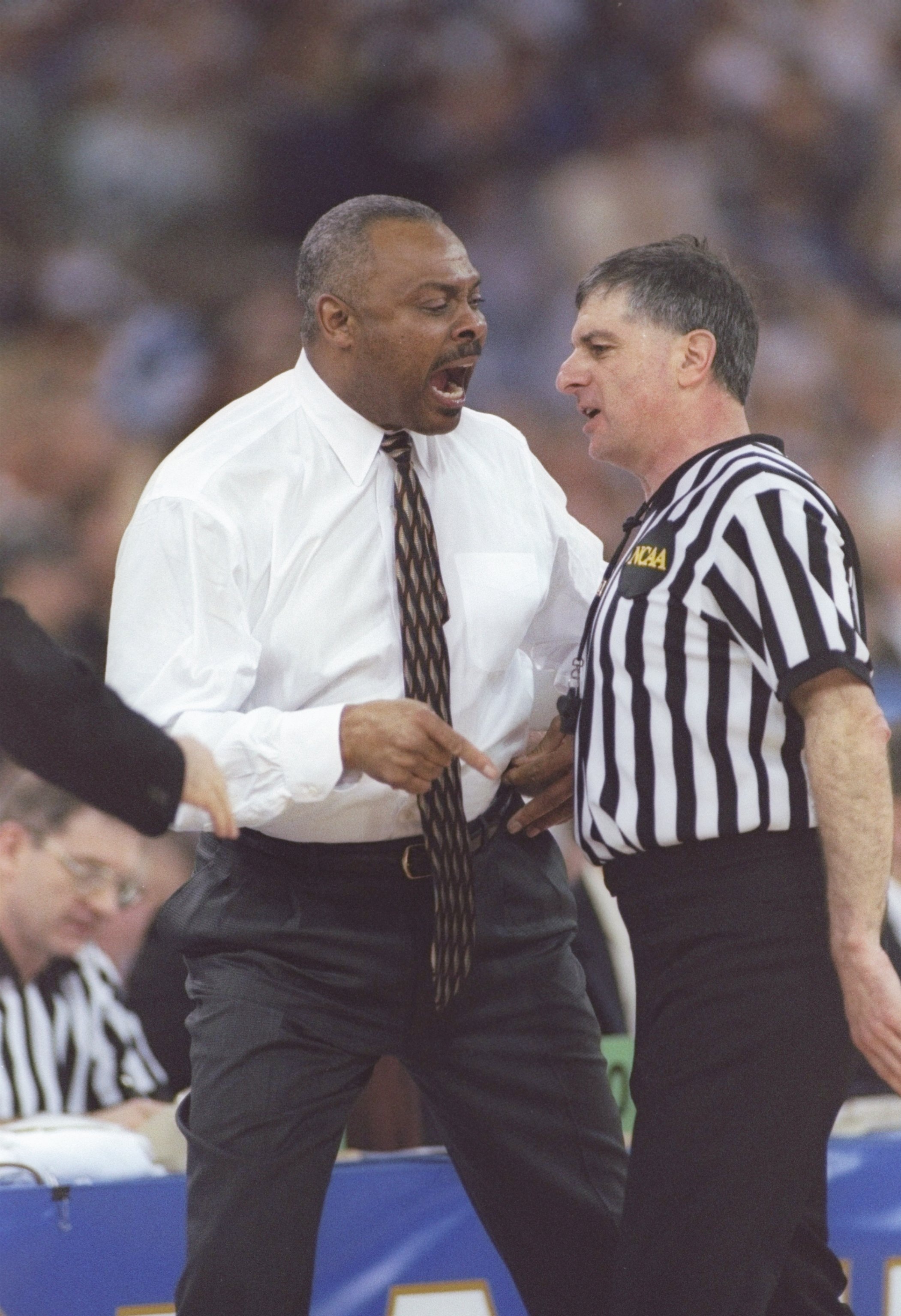29 Mar 1997:  Coach Clem Haskins of the Minnesota Golden Gophers argues with an official during an NCAA Final Four game against the Kentucky Wildcats at the RCA Dome in Indianapolis, Indiana. Kentucky won the game 78 - 69. Mandatory Credit: Brian Bahr  /A