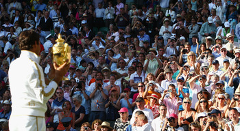 WIMBLEDON, ENGLAND - JULY 05:  Roger Federer of Switzerland celebrates victory with the trophy after the men's singles final match against Andy Roddick of USA on Day Thirteen of the Wimbledon Lawn Tennis Championships at the All England Lawn Tennis and Cr