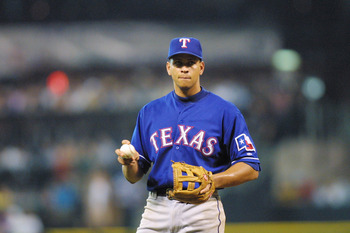 """Alex Rodriguez apparently practicing a """"split-fingered"""" grip while amidst a summer of losing with the Texas Rangers"""