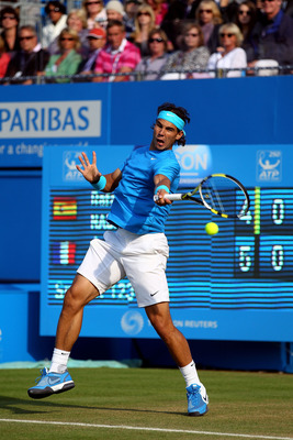 LONDON, ENGLAND - JUNE 10:  Rafael Nadal of Spain returns a shot during his Men's Singles quarter final match against Jo-Wilfred Tsonga of France on day five of the AEGON Championships at Queens Club on June 10, 2011 in London, England.  (Photo by Clive B