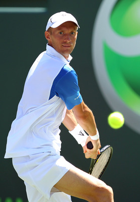 KEY BISCAYNE, FL - MARCH 23:  Nikolay Davydenko of Russia hits a return against Kevin Anderson of South Africa during the Sony Ericsson Open at Crandon Park Tennis Center on March 23, 2011 in Key Biscayne, Florida.  (Photo by Al Bello/Getty Images)
