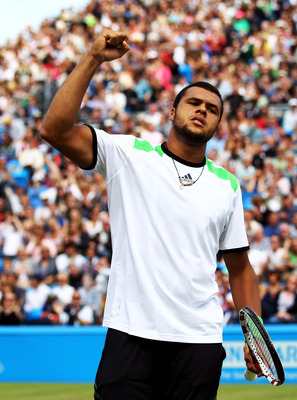 LONDON, ENGLAND - JUNE 13:  Jo-Wilfred Tsonga of France celebrates a point during his Men's Singles final against Andy Murray of Great Britain on day eight of the AEGON Championships at Queens Club on June 13, 2011 in London, England.  (Photo by Clive Bru