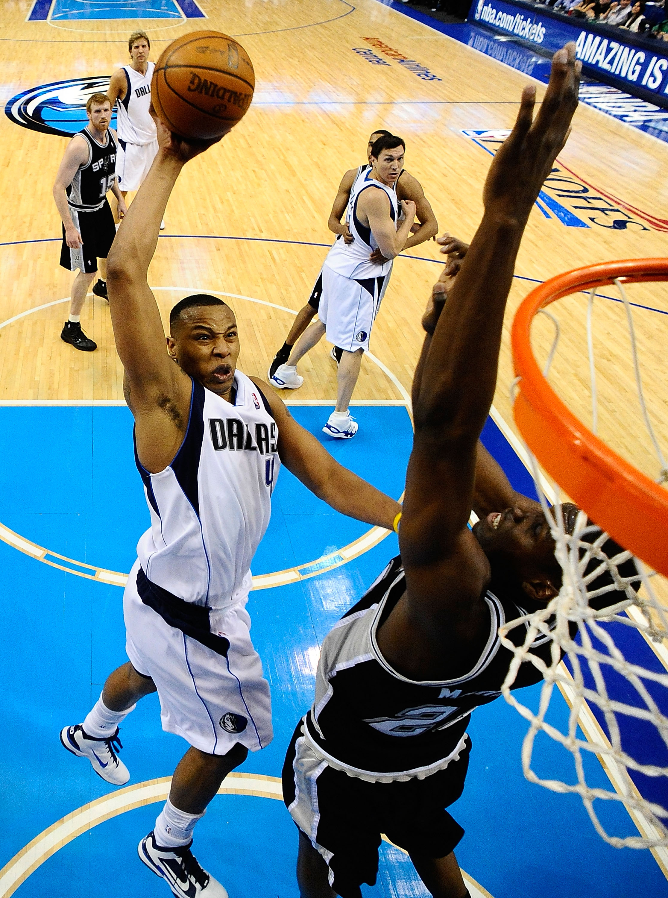 DALLAS - APRIL 27:  Forward Caron Butler #4 of the Dallas Mavericks takes a shot against Ian Mahinmi #28 of the San Antonio Spurs in Game Five of the Western Conference Quarterfinals during the 2010 NBA Playoffs at American Airlines Center on April 27, 20