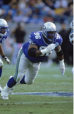8 Oct 2000  Cortez Kennedy  96 of the Seattle Seahawks gets ready to block 4a8289485