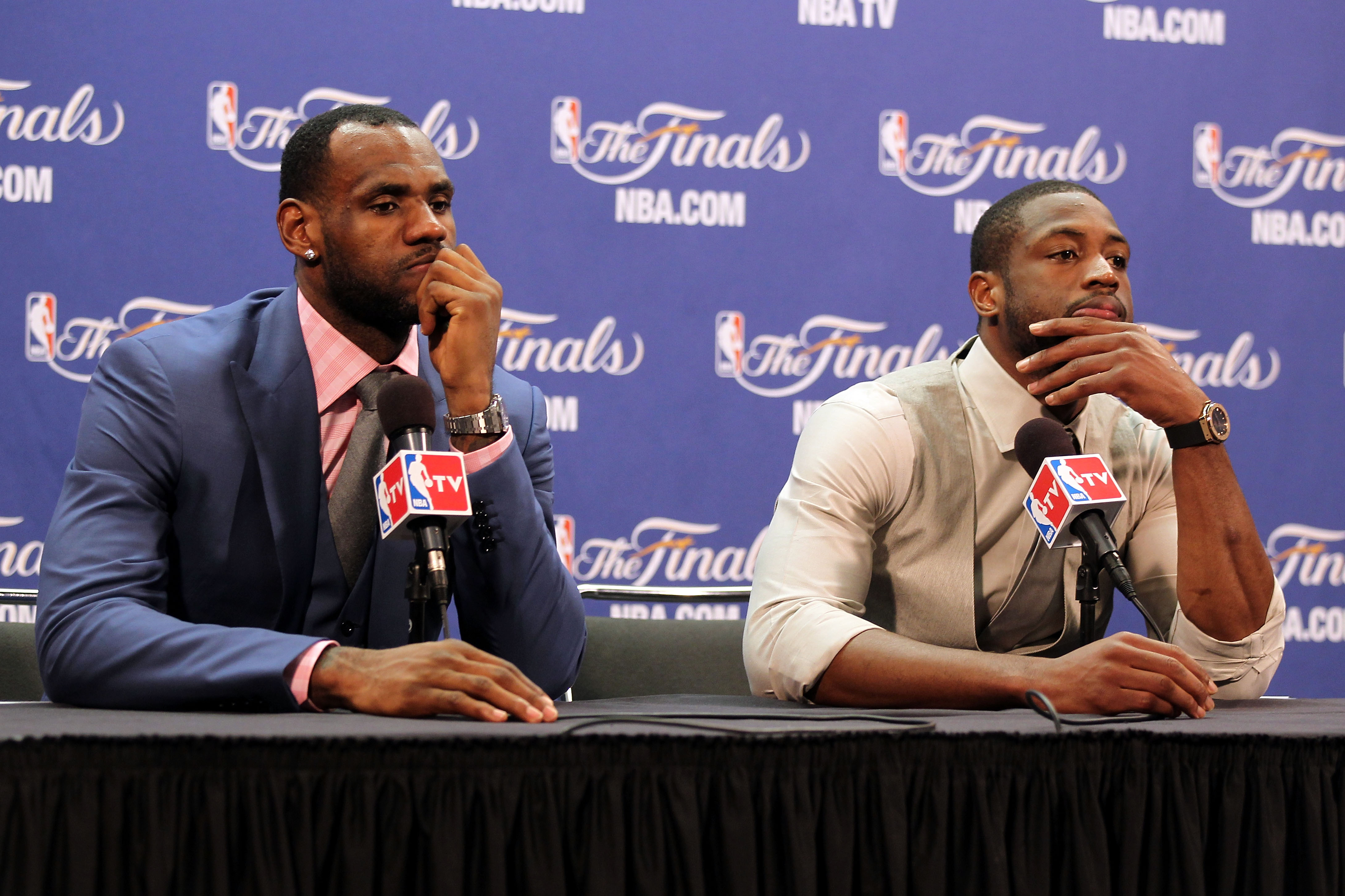 MIAMI, FL - JUNE 12:  (L-R) LeBron James #6 and Dwyane Wade #3 of the Miami Heat answer questions from the media at a post game news conference after the Dallas Mavericks won 105-95 in Game Six of the 2011 NBA Finals at American Airlines Arena on June 12,