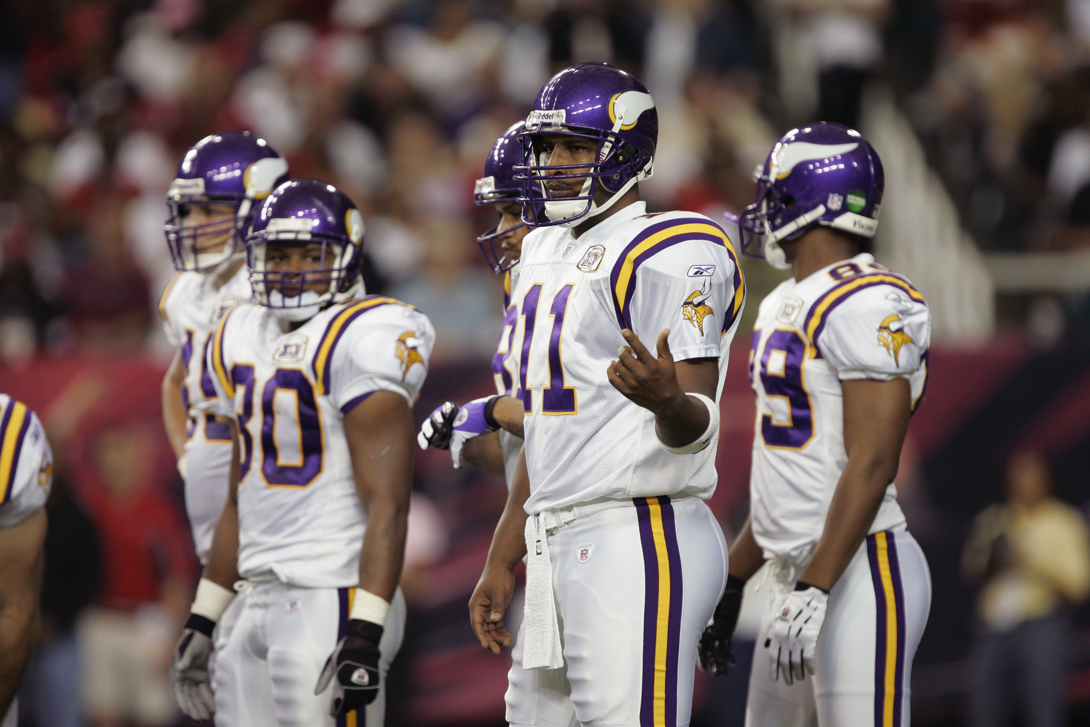 ATLANTA - OCTOBER 2:  Quarterback Daunte Culpepper #11 of the Minnesota Vikings waits for a play call from the sideline against the Atlanta Falcons on October 2, 2005 at the Georgia Dome in Atlanta, Georgia.  The Falcons won 30-10.  (Photo by Brian Bahr/G