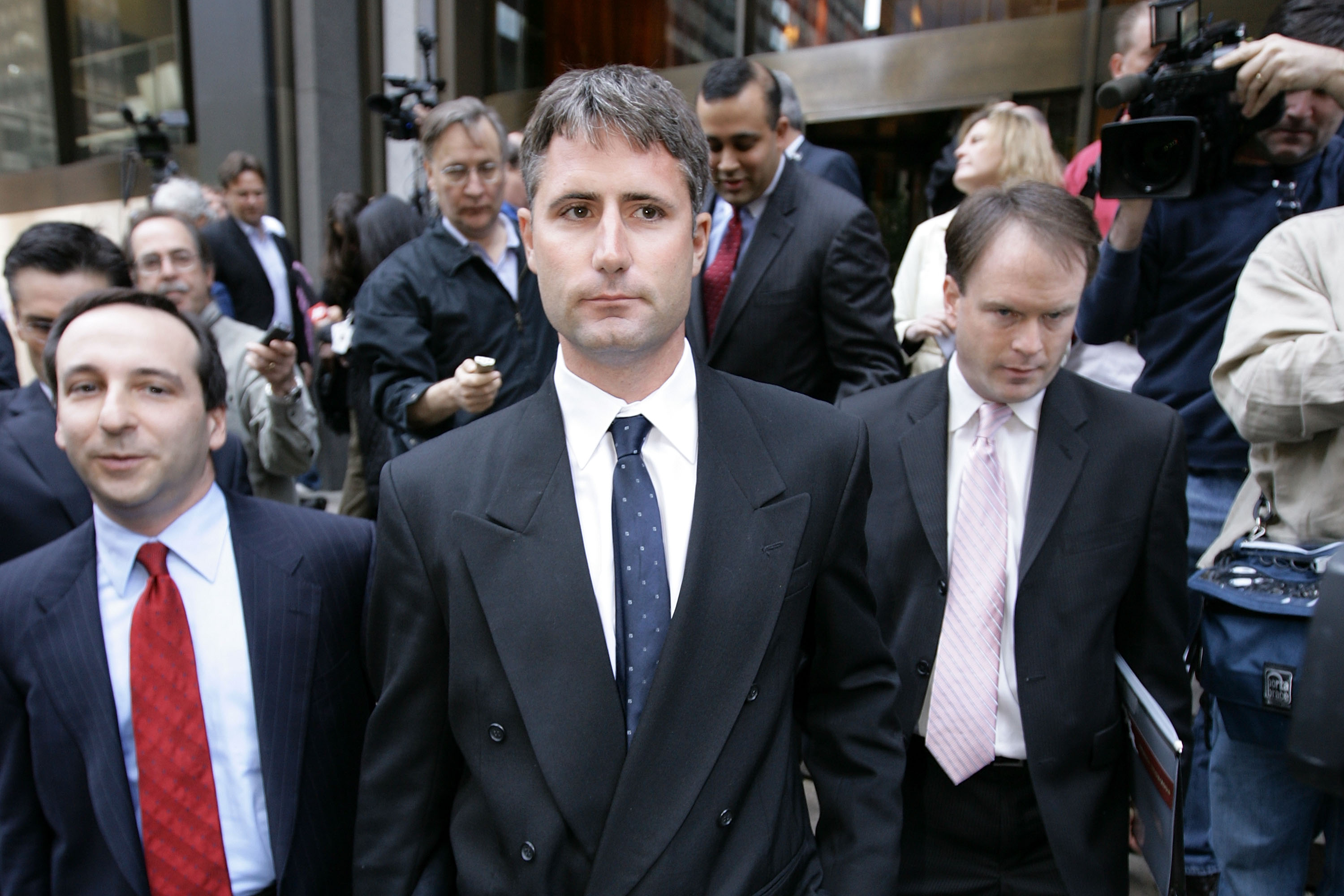 NEW YORK - MAY 13:  Former New England Patriots video operator Matthew Walsh (C) leaves NFL headquarters with his counsel Michael N. Levy (L) following a meeting with NFL commissioner Roger Goodell on May 13, 2008 in New York City. Walsh was there to disc