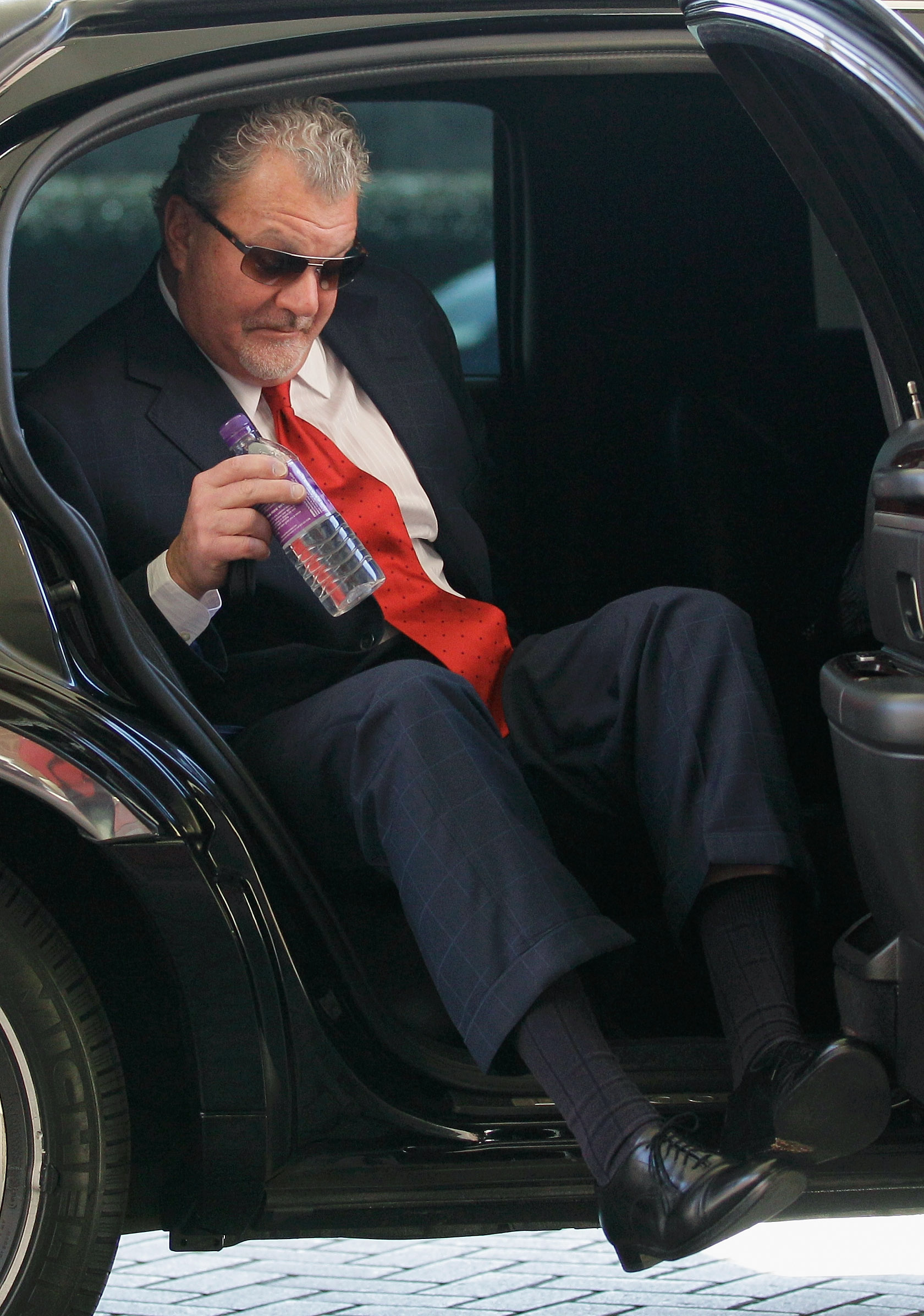 CHANTILLY, VA - MARCH 02: Indianapolis Colts owner Jim Irsay exits a car after arriving for a meeting of NFL owners at a hotel on March 2, 2011 in Chantilly, Virginia. The NFL owners are meeting in Chantilly to discuss negotiations with the players union
