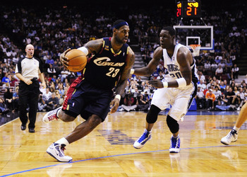 ORLANDO, FL - NOVEMBER 11:  LeBron James #23 of the Cleveland Cavaliers drives against Mickael Pietrus #20 of the Orlando Magic during the game on November 11, 2009 at Amway Arena in Orlando, Florida. NOTE TO USER: User expressly acknowledges and agrees t