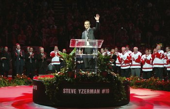 DETROIT - JANUARY 2:  Steve Yzerman of the Detroit Red Wings waves to the crowd as former players, family, and fans give a standing ovation after his speech to the Red Wings retiring his #19 prior to the Anaheim Ducks taking on the Detroit Red Wings durin