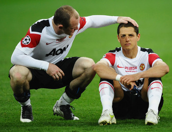 Rooney making a height joke. Chicharito is not pleased.