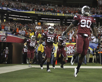 ATLANTA - DECEMBER 4:  Members of the South Carolina Gamecocks run out of the tunnel before the 2010 SEC Championship against the Auburn Tigers at Georgia Dome on December 4, 2010 in Atlanta, Georgia. (Photo by Mike Zarrilli/Getty Images)
